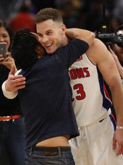 Detroit Pistons owner Tom Gores celebrates with Blake Griffin after defeating the Memphis Grizzlies, 104-102, at Little Caesars Arena on Thursday, Feb. 1, 2018 in Detroit.