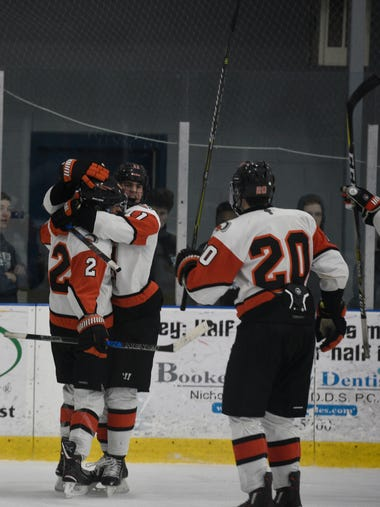 Pierce Cadieux congratulates Ethan Nystrom (2) after
