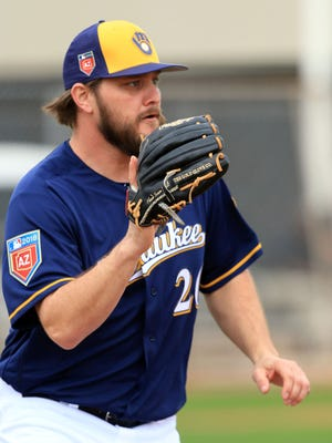 Brewers pitcher Wade Miley covers first base.