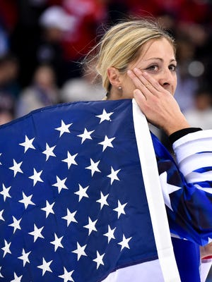 United States forward Gigi Marvin (19) wipes away a tear while celebrating after defeating Canada in the women's ice hockey gold medal match during the Pyeongchang 2018 Olympic Winter Games at Gangneung Hockey Centre.