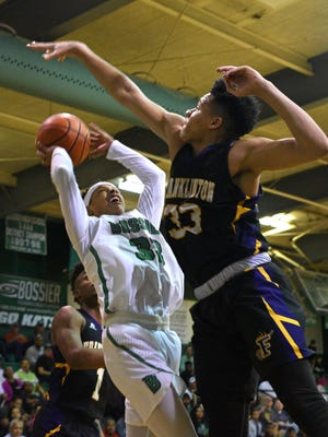 Bossier's Tim King tries to score over Franklinton's Tylan Pope during Friday's LHSAA Class 4A state playoff game in Bossier City.