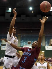 Lanier's Earl Smith (3) gets the shot off against New
