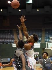 Callaway's James Williams (1) scores on a jump hook against Stone at the MHSAA C Spire State Basketball Tournament at the Mississippi Coliseum in Jackson, Miss., on Friday, March 2, 2018.