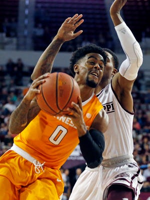 Tennessee guard Jordan Bone (0) attempts to drive around a Mississippi State player in the first half of an NCAA college basketball game in Starkville, Miss., Tuesday, Feb. 27, 2018. Tennessee won 76-54. (AP Photo/Rogelio V. Solis)