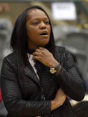 Murrah head coach Tangela Banks watches the Lady Mustangs