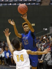 Murrah's Nya Irvin (23) hits a long three pointer at the end of the first quarter on Wednesday in a semifinal game of the MHSAA Class 6A state semifinals at the Mississippi Coliseum in Jackson.