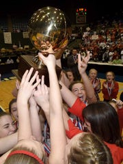 The Pine Grove Lady Panthers celebrate with the Class