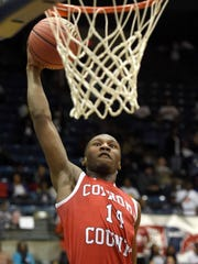 Coahoma County's Markevius Phillips (14) dunks against