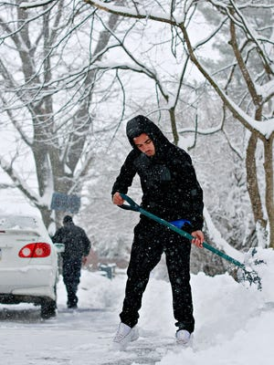 Nicolas Clark, 17, front, shovels with his father William Clark, back, and two brothers (not pictured) as snow continues through Winter Storm Toby in Springettsbury Township, Wednesday, March 21, 2018. Dawn J. Sagert photo