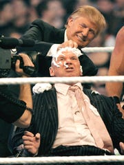 Donald Trump shaves Vince McMahon's head during a WrestleMania