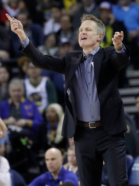 Golden State Warriors head coach Steve Kerr gestures during the first half of an NBA basketball game between the Warriors and the Utah Jazz in Oakland, Calif., Sunday, March 25, 2018. (AP Photo/Jeff Chiu)