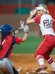 Second baseman Casidy Chaumont (24) tries to turn the