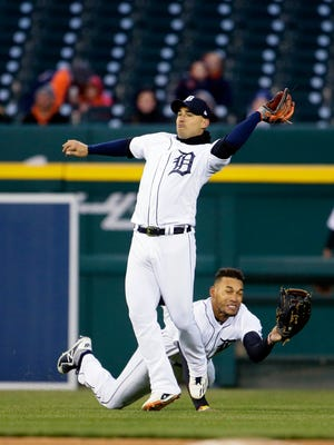 Tigers shortstop Jose Iglesias falls to the ground after colliding with left fielder Victor Reyes, after catching a fly ball hit by the Pirates' Gregory Polanco in the fifth inning of Game 2 of a doubleheader at Comerica Park on April 1, 2018.