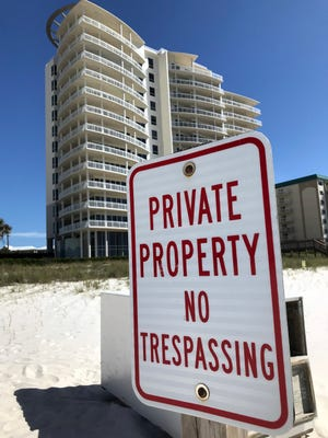 No trespassing signs line Perdido Key on Tuesday, April 17, 2018. Escambia County Commissioner Grover Robinson has proposed putting a wide swath of Pensacola Beach into permanent conservation status in an effort to prevent the kind of limited access beach-goers face in other parts of the state.