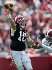 Alabama quarterback Mac Jones (10) throws under pressure from Alabama linebacker Markail Benton (36) during the A-Day Game at Bryant-Denny Stadium on the University of Alabama campus in Tuscaloosa, Ala. on Saturday April 21, 2018.