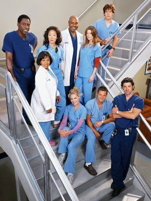 "A cast shot from the early years of ""Grey's Anatomy"" features Isaiah Washington, left, Chandra Wilson, Sandra Oh, James Pickens, Jr., Ellen Pompeo and T.R. Knight at the rear and Katherine Heigl, left, Justin Chambers and Patrick Dempsey in front."