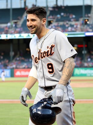 Nicholas Castellanos smiles after scoring a run in the third inning against the Rangers on May 7, 2018 in Arlington, Texas.