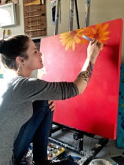 Artist Sarah Justice works in her studio.