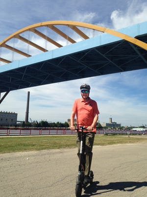 Columnist Jim Stingl tries out a Bird scooter near the Summerfest grounds and Hoan Bridge. The scooters are available for anyone to use at a small cost, but Milwaukee city officials are saying they're illegal to operate here.