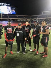 Parkway head football coach Neil May poses with some