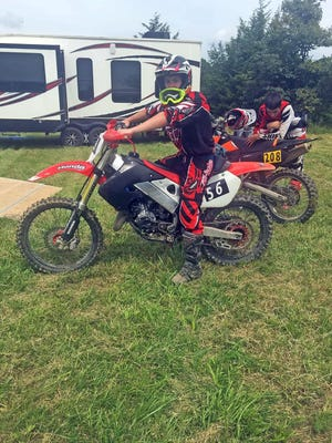 Claytan Jobe and Riley Knapheide prepare to race Saturday at Midwest Off Road Events LLC at Knobby Creek. Jobe's first dirt bike race was Saturday over the weekend event.