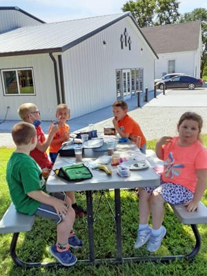 Zion Lutheran School students enjoyed the changing weather Sept. 8 with a picnic lunch.
