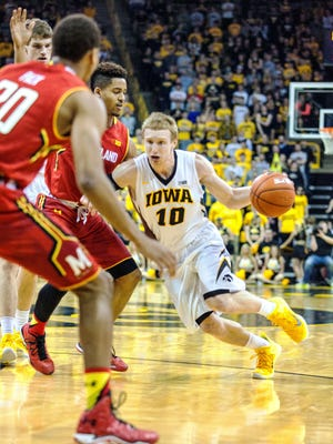 Iowa's Mike Gesell (10) penetrates the lane during a 71-55 win over Maryland, in which he recorded a career-best nine assists. Gesell is averaging 8.5 points and 3.5 assists in Big Ten play.