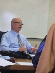 Wausau Transit Director Greg Seubert speaks to the Transit Commission on Sept. 18, 2014 at the municipal airport in Wausau regarding a potential fare increase.