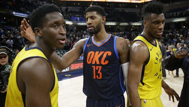 Oklahoma City Thunder Paul George (13) greets Indiana Pacers Victor Oladipo (4) and Thaddeus Young (21) following their game at Bankers Life Fieldhouse Wednesday, Dec 13, 2017. The Oklahoma City Thunder defeated the Indiana Pacers 100-95.