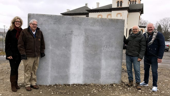 This concrete slab outside the Community Arts of Elmira building on Lake Street will soon be the canvas for a new public art wall. From left are Community Arts President Lynne Rusinko, board member Robert Butcher, Vice President Joe Caparulo and Elmira City Council member Brent Stermer.