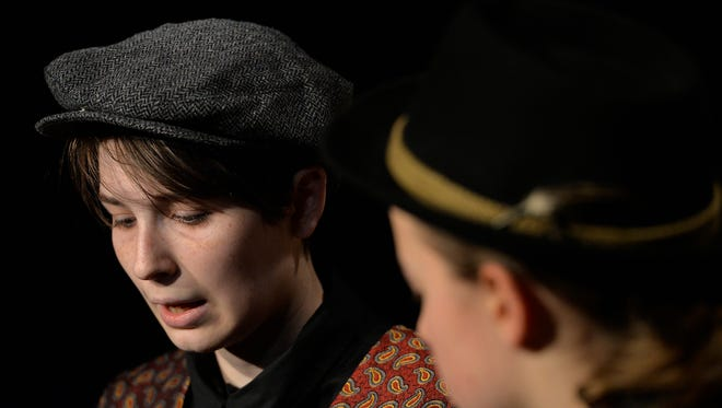 """Sebastian, left, (Callista Sorteberg) and The Captain (Gwyneth John) rehearse Wednesday in the St. John's Prep version of Shakespeare's """"Twelfth Night."""" The play keeps the original dialogue but the setting takes a more modern approach and is inspired by the 1980s."""