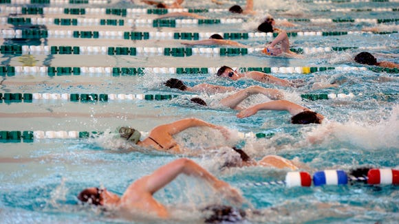 Surf Rescue Technician candidates begin a timed 500-meter swim during one of Ocean City Beach Patrol's physical skills evaluations, on Saturday, Feb. 28, 2015 at York College's Grumbacher Sport & Fitness Center. Almost 50 Surf Rescue Technician candidates participated in the evaluations, which included various outdoor and swimming sprints.