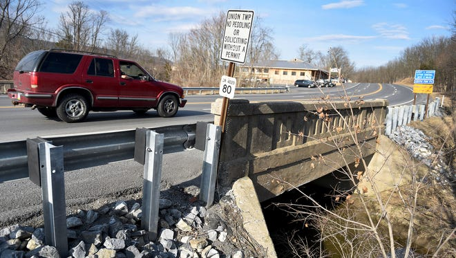 An SUV crosses the Fisher Avenue bridge in Union Township this week. The bridge will be replaced in 2017 under the Rapid Bridge Replacement Project.