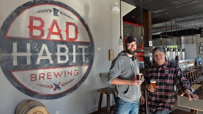 Aaron Rieland, left, and Eric Geier started Bad Habit Brewing Co. in St. Joseph one year ago. They are shown at the brewery Monday, Oct. 24.