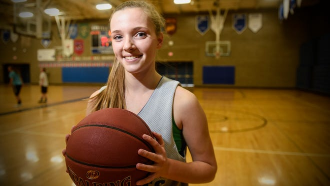 Sartell's Alexie Winter smiles Tuesday, March 7, during a break in practice at Sartell High School.