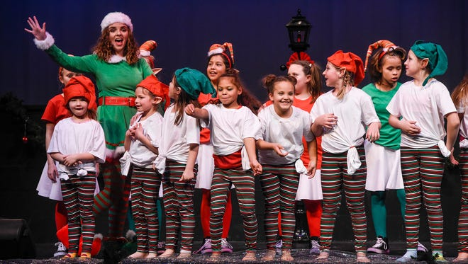 """Cast members finish performing """"The Big One"""" Wednesday, Dec. 20,  near the end of the Youth Arts Initiative Holiday Showcase at the Eastside Boys & Girls Club in St. Cloud."""