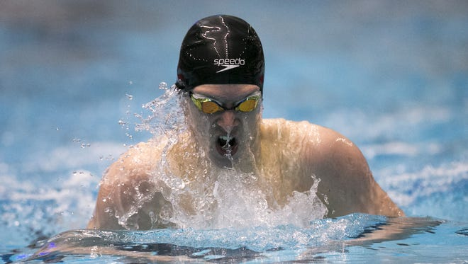 Wyatt Davis, Carmel's winner in the 200 yard IM, competes during the IHSAA Boys' Swimming State Finals, Indianapolis, Saturday, Feb. 24, 2018.
