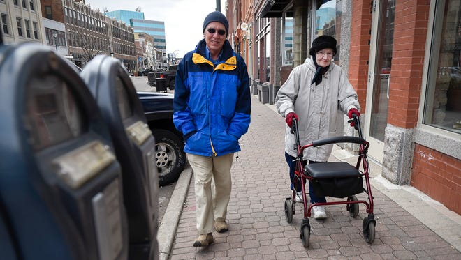 Irene Pundsack, 91, gets in a 3-mile training walk with her son Gene around downtown St. Cloud Wednesday, April 18, in preparation for the St. Cloud Subaru 5K Run/Walk Friday.