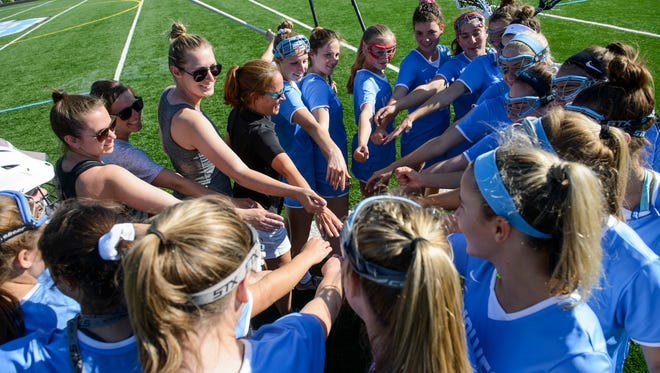 South Burlington huddles together during the girls lacrosse playoff game last week.