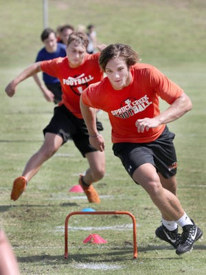 Spruce Creek football team members began summer conditioning on July 6. The Florida High School Athletic Association's board of directors voted to continue with next Monday's scheduled start of the fall season.