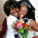 Brittney Thompson, right, gets a big hug from her mother, Jeanette Thompson, following the Hinds Community College graduation at the Muse Center on the Rankin Campus. Hinds conferred 443 degrees and certificates to 304 graduates for this summer's ceremonies.