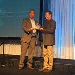 Richard Jeo, right, of The Nature Conservancy, receives an award from Eric Alvarez of U.S. Fish and Wildlife Service.