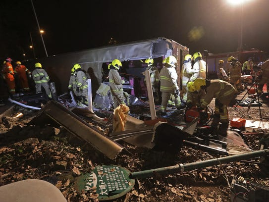 Firemen work at the scene of a bus crash in Hong Kong.