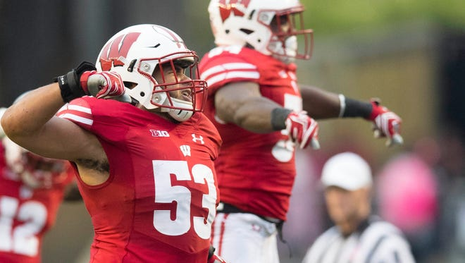 UW linebacker T.J. Edwards grew up a fan of Illinois football but is happy he landed with the Badgers.