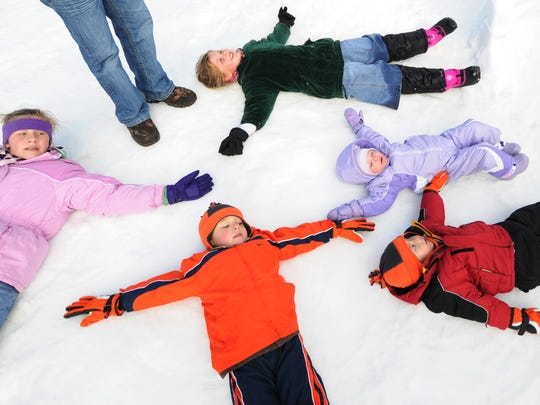 Making snow angels is not only a lot of fun, it also burns calories.
