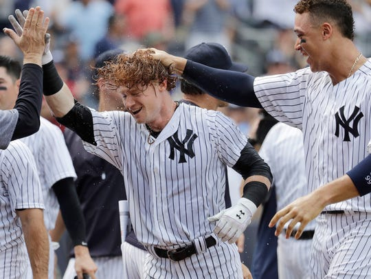 New York Yankees' Clint Frazier, center, is congratulated