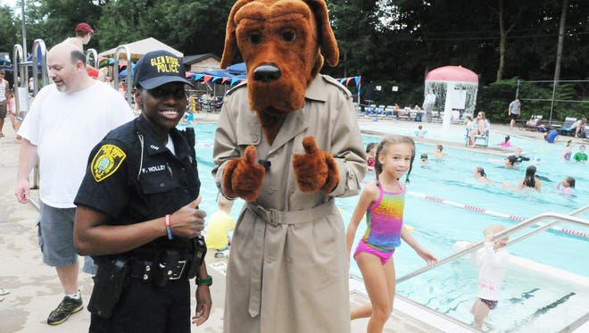 Glen Ridge police officer Fuquannah Holley visits pool patrons with McGruff the Crime Dog during a previous National Night Out.