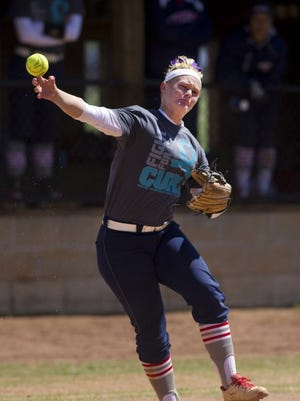 Southern Indiana third baseman Mena Fulton makes a throw to first against Indianapolis at USI Softball Field on April 2, 2016.