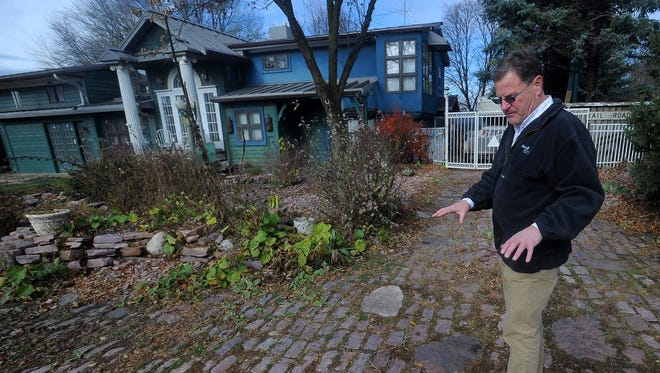 Bruce Danielson talks about the cobblestones that he laid in the front yard of his northwest Sioux Falls home on Wed., Nov. 18, 2015.