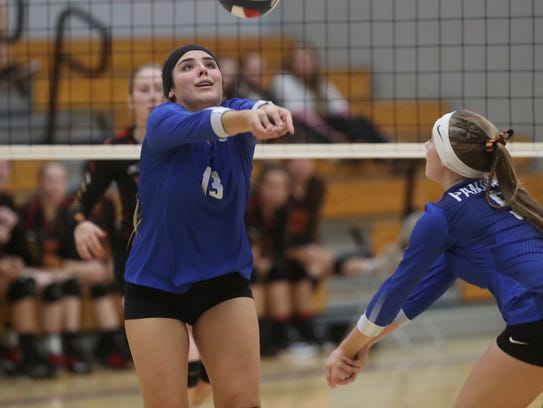 University Prep's Savannah Cordova (left) hits a ball in the Panthers' playoff win over Yreka on Tuesday.